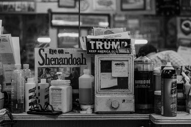 A President Trump support sticker sits among the cosmetics at a barber's shop in Shenandoah, a city in the coal mining region of Pennsylvania.