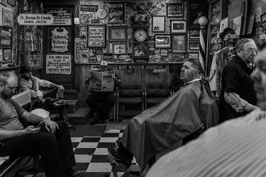 Men wait to get their haircut at a barber's shop in Shenandoah, a city in the coal mining region of Pennsylvania.