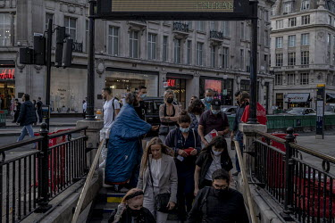 People enter the underground at rush hour in Oxford Circus, normally an area that would be crowded with commuters and shoppers.