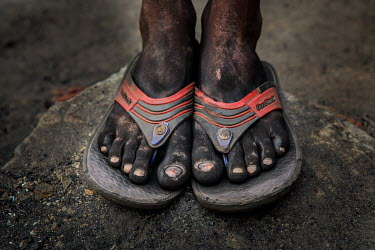 Day labourer's feet tell their tales. Thousands of men, women and children toil in the open their muddy clothes, coal dust engrained skins and bare feet reveal how everyday they struggle to live a lif...