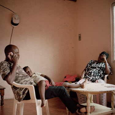 Paul Mananga (43), a migrant from Congo, with his wife Nacha and one of their three children in the small one-bedroom apartment they have rented in Tapachula. They say they left Congo due to political...