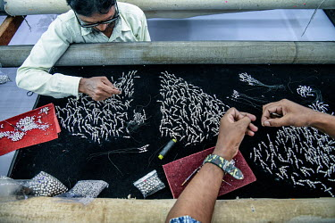 Labourers attach beads and sequins to fabrics in a factory in Lower Parel that is part of Maximiliano Modesti's Les Ateliers 2M, a Mumbai embroidery firm that works with many luxury western brands. Un...