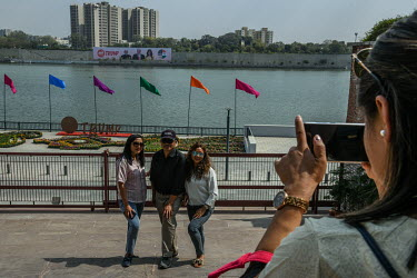 People take photographs on the banks of the Sabarmati River near the Gandhi Ashram (Sabarmati Ashram), one of the sites that US President Donald Trump was due to see during a state visit to India.