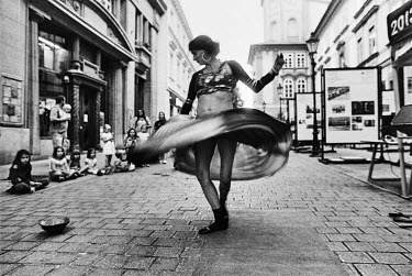 A street performer dances near the Namesti Republiky (Republic Square).