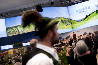 Visitors at the Bavarian booth in the agriculture section of the Gruene Woche, International Green Week, the world's largest international agricultural trade fair for food and agriculture products. So...