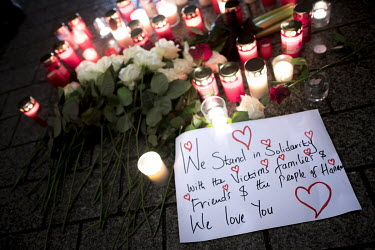 Flowers, candles and a message of support form an impromptu memorial as people gather near the Brandenburger Gate in a show of solidarity following a shooting the previous day in Hanau. The suspect To...
