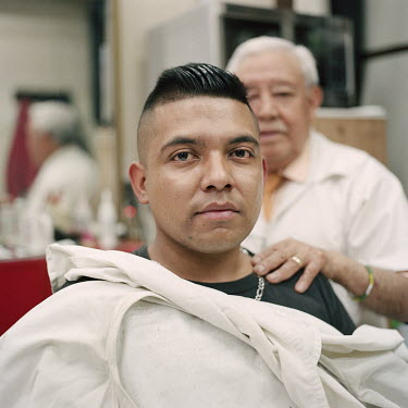 Bryan M (21) at a barber near the call centre he works at in central Mexico City. Born in Mexico, he moved with his family to the US when he was three years old, and stayed until he was 16, when he wa...