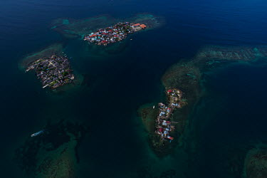 An aerial view of three islands inhabited by Guna people in the San Blas Archipelago. Islands in the archipelago are suffering from destructive tidal surges and human overpopulation, forcing the indig...