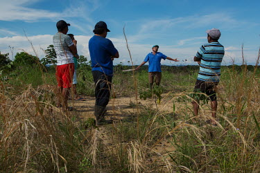 Guna leaders visit Barriada, a place on the mainland where they will resettle families coming from islands in the San Blas Archipelago. Islands in the archipelago are suffering from destructive tidal...