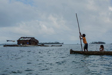 The young sons of fisherman Tony Castro Perez return to their home on Ant Island (Sichirdub) in the San Blas Archipelago, after fishing. Islands in the archipelago are suffering from destructive tidal...