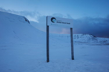A sign outside the Global Seed Vault where, in recent years, the main tunnel has experienced some flooding due to permafrost melt. Temperatures in this region are warming faster than anywhere else on...