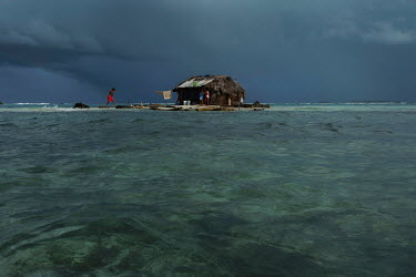 The hut of fisherman Tony Castro Perez on Sichirdub Island, or Ant island, in the San Blas archipelago, where he spends three months a year fishing with his six children. Destructive tidal surges and...