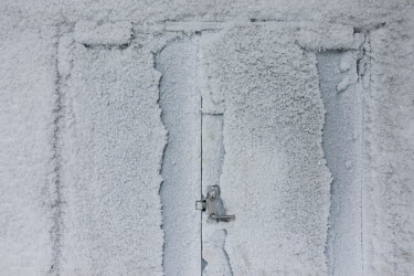 An ice-encrusted door inside the Global Seed Vault where, in recent years, the main tunnel has experienced some flooding due to permafrost melt. Temperatures in this region are warming faster than any...