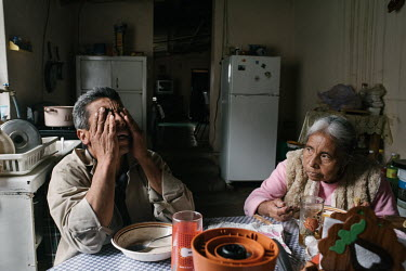 Gerardo Carmona has breakfast with his mother Socorro Gutierrez. He is the last of eight children, and the only one who stayed and worked in the family farm.