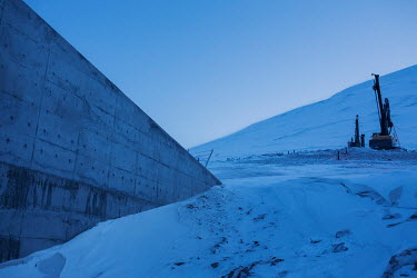 The entrance tunnel to the Global Seed Vault where, in recent years, the main tunnel has experienced some flooding due to permafrost melt. Temperatures in this region are warming faster than anywhere...