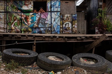 Second hand truck tires used to protect the foundations of a stilt house from high tides in the Mangue Seco slum.