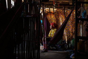 The Guna leader, Victoria Navarro l, rests in a hammock in his home on the island of Carti Sugdub, in the San Blas archipelago, in Panama.