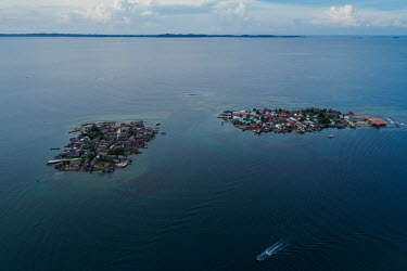 An aerial view of two islands inhabited by Guna people in the San Blas Archipelago. Islands in the archipelago are suffering from destructive tidal surges and human overpopulation, forcing the indigen...