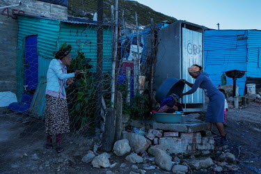 Women use a community tap to wash clothes in the township Station 11 in Villiersdorp, near Theewaterskloof reservoir. In early 2018, when the dam's water was predicted to decline to critically low lev...