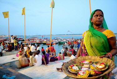 A woman selling votive candles on the banks of the Ganges River.