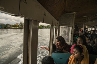 Passengers on a ferry boat sailing from the Jetty of Fort Kochi.
