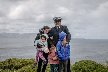 Chilean navy officer Andres Morales with his wife Catalina Henriquez and children, Martin (blue coat), Amanda (2), and Isidora. The family are stationed on Cape Horn Island (Isla Hornos) for a year wh...