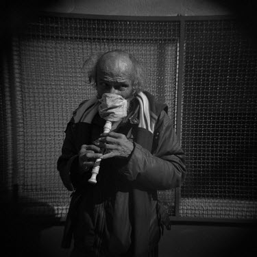 Gerardo Elias Gutierrez (57) plays a recorder (pipe) a he busks for money outside a hospital treating people suffering with COVID-19. He's been playing for the families of hospital patient for 25 year...