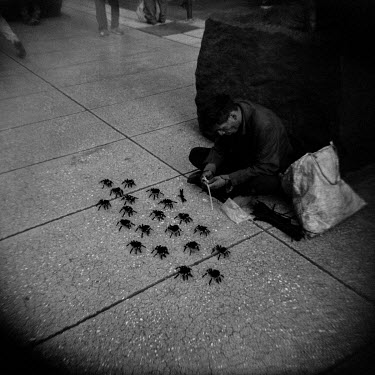 A man makes spiders made out of pipe cleaners to sell them to passersby on Madero, a pedestrianised street in the city centre that was soon to be closed to the public as part of the city's response to...