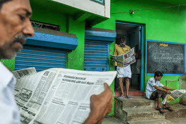 Locals read newspapers in a club building in Mattancherry.