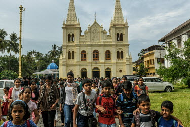 People leave the Santa Cruz Chatedral Basilica in Fort Kochi after a service.