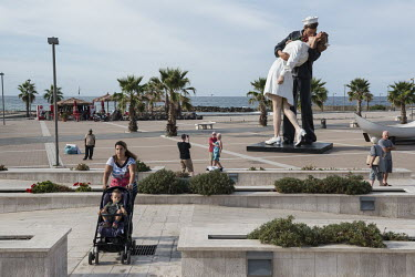 A giant statue on the sea front of a navy rating kissing a woman. The statue is based on an iconic photograph by Alfred Eisenstaedt of a sailor kissing a stranger, in a nurse's uniform, in Times Squar...