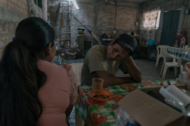 Santos has breakfast along her wife Justina at their home. Santos and his sons Alex (13) and Marvin (10) have all joined the Regional Coordinator of Community Authorities (CRAC-PF) community police fo...