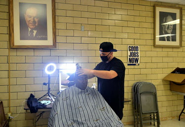 Local 1016-03 United Steel worker Jeffrey Heckathorn (32) cuts Bruce Harold's (63) hair for free, a service he offers every Monday at the Steel Workers Union HQ while the steelworkers are on strike.