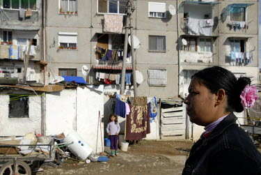 A woman and child outside a housing block in a gypsy neighbourhood.