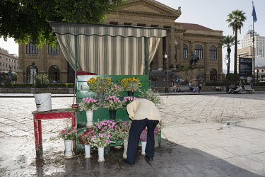 A flower stall in front of the Teatro Massimo Vittorio Emanuele, an opera house on the Piazza Verdi.