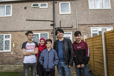 The Daour family, (L-R) Haitham (16), Noura (44), Daour (12), Sakkar (43) and Shayesh (17), in the back garden of their home. The family, originally from Syria, have been supported in their resettleme...