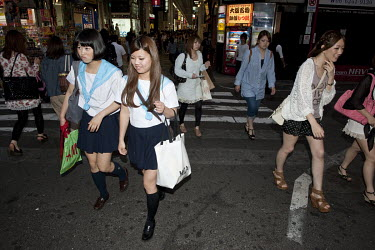 Schoolgirls in uniform shopping in the Dotombori entertainment district.
