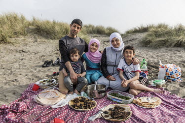 Muhaned Alchik, his wife Naheda and children Shadi (8), Sara (9) and Hadi (1) enjoy a picnic at the beach.    The Alchik family, originally from Syria, have been supported in their resettlement by t...