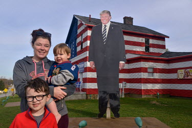 Marissa Smith (28), a nursing student with her sons Jaxon (5) and Grayson (1), the next-door neighbours of Leslie Rossi whose house (known locally as 'Trump House'), which they are standing outside of...