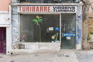 A closed-down and abandoned travel agency in the town that was once a communist stronghold and the hometown of Companhia Uniao Fabril (CUF) which, from the 1930s until 1974, was one of Portugal's bigg...