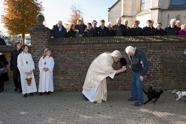 After mass for Saint Hubertus, the patron saint of hunters, the pastor blesses horses and domestic animals.