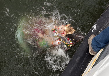 Members of the Indian Hindu community celebrating Ganesh Chaturthi throw a plaster statue of Ganesha into the Schelde River following a procession to the water's edge.