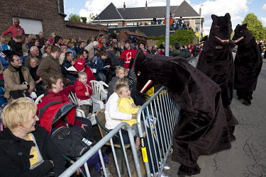 People dressed as bears with snapping teeth scare children in the audience during the procession of Ros Beiaard of Dendermonde which takes place every ten years.