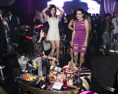 Women dacing in a nightclub on New Year's Eve.
