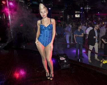 A dancer performs on stage at a nightclub.