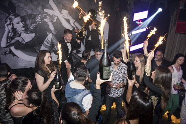 Champagne with fireworks attached to the bottles is served to guests at the Provocateur nightclub, in the Four Seasons Resort.