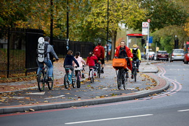 People riding bicycles along cycle path in Rotherhithe, Southwark