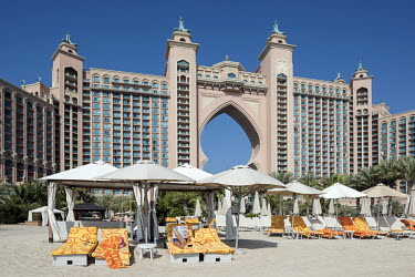 SUn loungers on the sand at the Atlantis, The Palm hotel, on the Palm Jumeirah artificial island. It was the first resort to be built on the island and is themed on the myth of Atlantis.