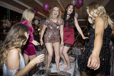 British expats dancing on a table during a 'Candypants Party' on New Year's Eve at the XL nightclub.