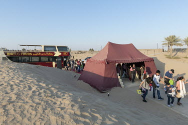 A BigBus Tours group arrives at the bedouin inspired Al Sahra Desert Resort.